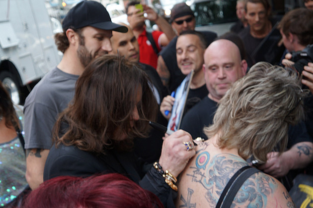 Ozzy Signing Fan's Back
