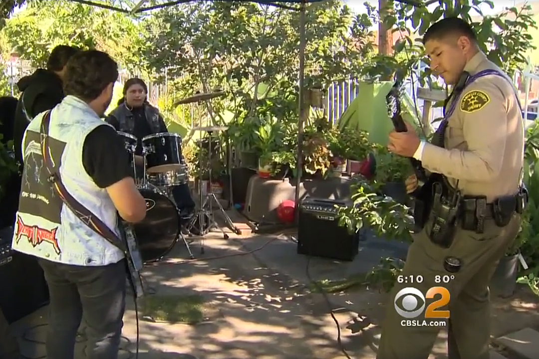 Coolest Cop Ever Crashes Band's Practice Session to Jam Iron Maiden + The Offspring